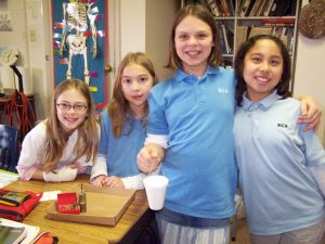 ECA Girls and Weight Science Experiment